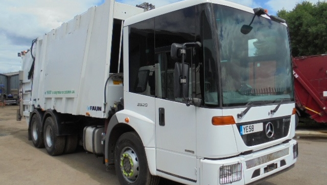 2007-2008 YEAR MERCEDES ECONIC REFUSE VEHICLE WITH FAUN BODY AND TERBERG BIN LIFT