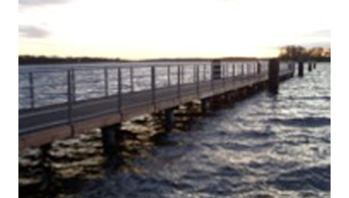 Completed jetty using composite piles and grooved no-slip decking