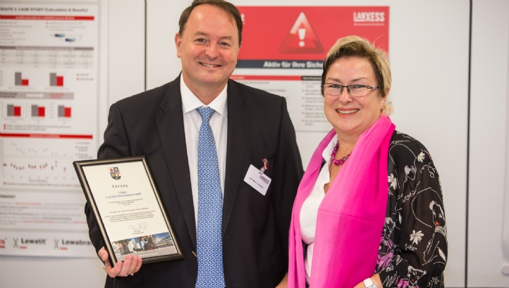 Lanxess head of liquid purification technology, Jean-Marc Vessel, is congratulated by Bitterfeld-Wolfen city mayor, Petra Wust, on five years of membrane production in Bitterfeld, Germany