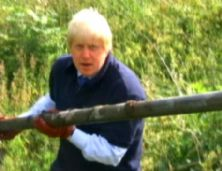 Mr Johnson clearing a river in south London last year