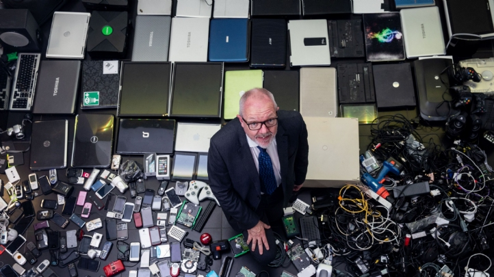 The Royal Society of Chemistry's chief executive Robert Barker, pictured with some of the redundant tech gathered by staff at the organisation's Cambridge HQ during an amnesty