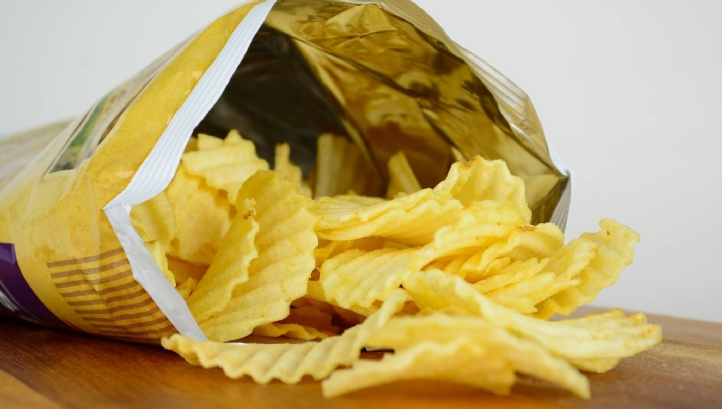 Although the inside of conventional crisp packets are shiny and look like foil, they are in fact a metallised plastic film
