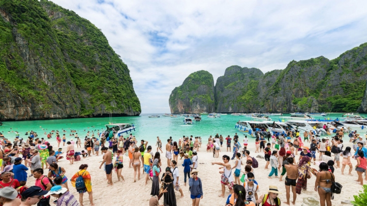 Maya Bay in Thailand (pictured) attracted 5,000 tourists a day before the government closed the area over environmental concerns