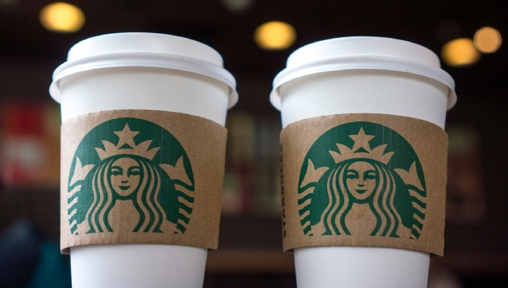 Starbucks trials compostable paper cups, places ban on