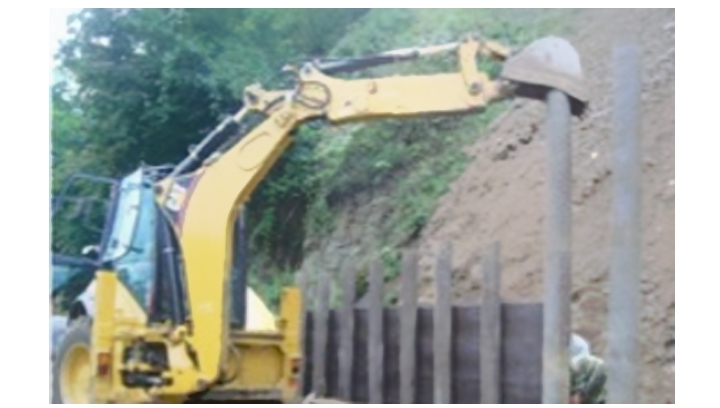 Revetments made from composite piles and boards to prevent land slip