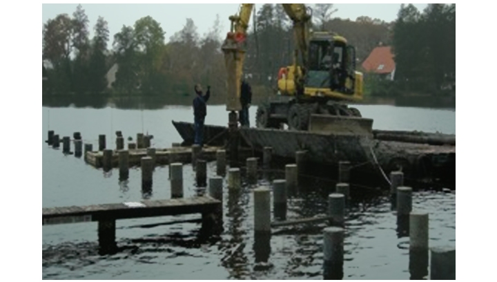 Jetty under construction using composite pilings