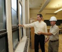 Dalton McGuinty (left) is showed how the school is being greened