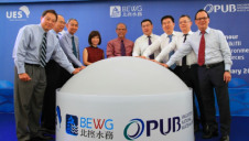 PUB chief executive Ng Joo Hee (left), and PUB chairman Tan Gee Paw (second from left), join colleagues in celebrating the opening of BEWG-UESH NEWater Plant