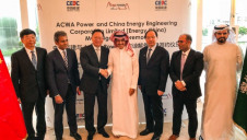 (Third from left) Energy China chairman Wang Jianping shakes hands with ACWA Power chairman Mohammad Abunayyan; supported by (second from left) ACWA Power chief executive Paddy Padmanathan