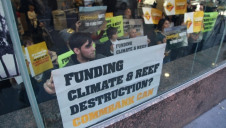 Activists protesting in Sydney in May against coal financing by the Commonwealth Bank. Photo: Kate Ausburn
