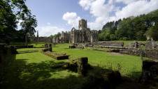 The Trust looks after 780 miles of coastline and 248,000 hectares of land, as well as its 500+ visitor sites. Pictured: Fountains Abbey, Yorkshire
