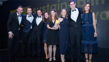 Global Action Plan's Chris Large (left) and compere Julia Bradbury presenting the Barry Callebaut team with the award