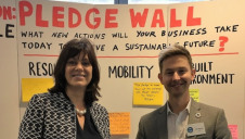 Energy Minister Claire Perry and edie's content director Luke Nicholls stood in front of a real-life version of the Mission Possible Pledge Wall at the Sustainability Leaders Forum in London