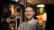 "To communicate its investment, Tennent's will be lighting the famous ""big red T"" in the signage of its Wellpark site in green, and using the green logo on a line of limited-edition pint glasses. Image: Tennent's."