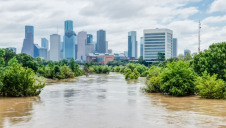 Costs could rapidly rack up without proper climate mitigation and adaptation, the report warns. Pictured: Flooding in Texas following Storm Harvey in 2017